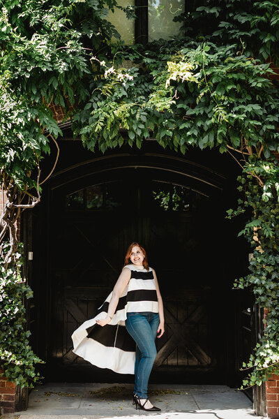 woman with stripped shirt with ivy door