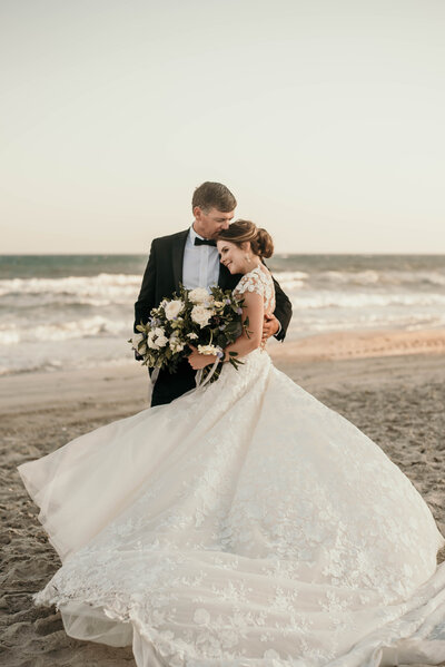 A bride and groom at the beach