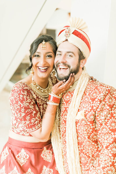 Multi-cultural indian wedding photo of married couple