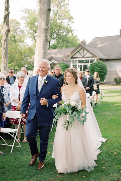 Bride walks down the aisle at her Owosso Country Club Wedding in Lansing, Michigan