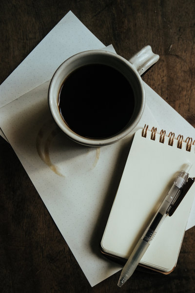 Photograph of notepad & Pen and coffee cup