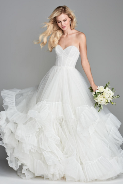 Full of volume and glamour, this classic ball gown is updated with tiered layers of pleated Tulle, finished with a Horsehair hem.