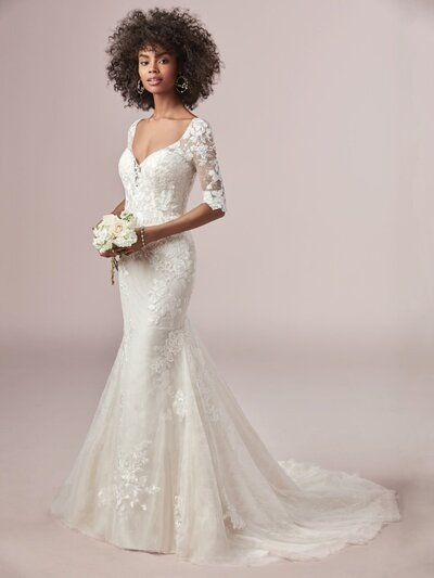 Fit-and-Flare Wedding Dress with Sleeves. Looking for a unique fit-and-flare wedding dress with sleeves? A ravishing neckline and romantic illusion make this an uncommonly sophisticated choice for your big day.