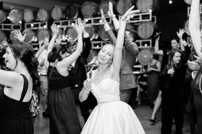 Bride dancing at her wedding in Napa Valley, California. Wedding photo taken by Cheers Babe Photo.