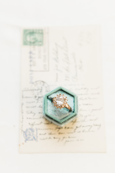 antique engagement ring in a mrs box flatlay