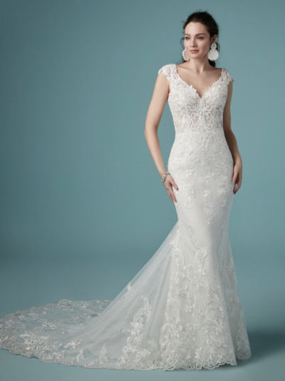 Sheath Wedding Dress Favorite Beaded embroidered lace motifs cascade over Chantilly lace in this soft sheath wedding dress, accenting the illusion double-lace train. The bodice features a delicate V-neckline, sheer cap-sleeves, and scoop back, all accented in beaded lace motifs. Finished with covered buttons over zipper closure.