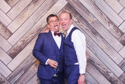 LGTB couple rustic backdrop