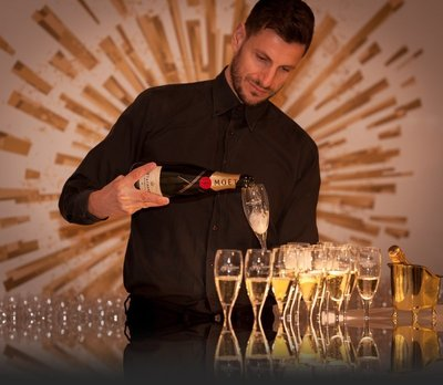 professional bartender pouring champagne