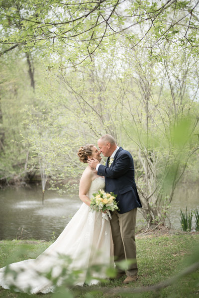 Bride and Groom by the pond at the Golden Horseshoe Inn