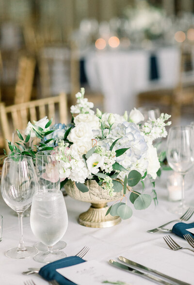 wedding reception table with white flowers