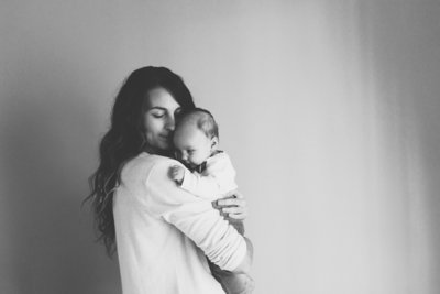 Canva - Happy Mother Holding Adorable  Baby Girl