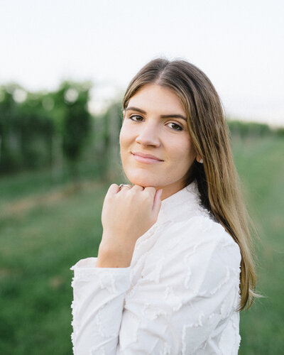 Olivia Morgan at a vineyard for weddings in Alabama