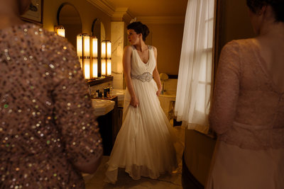 008-bride-getting-ready-at-stoke-park-hotel--country-house-wedding-photographer