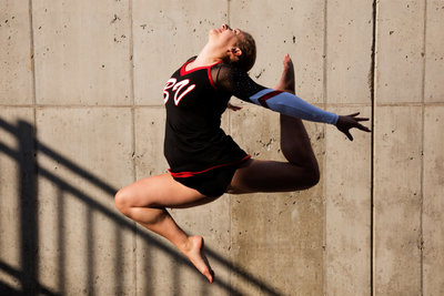 sioux falls senior photography cheerleader leaping against stairway shadow downtown sioux falls south dakota brandon valley lynx