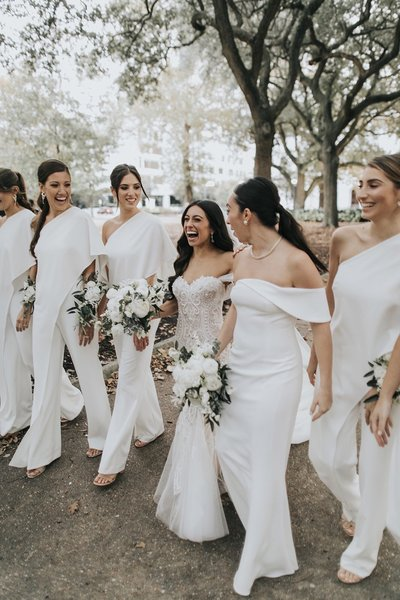 White bridesmaids jumpsuits