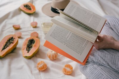 opened-book-and-sliced-papaya-fruit-3060323