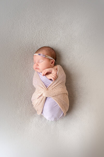 newborn-baby-swaddled-in-a-blanket