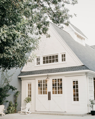 beautiful white home exterior with white siding and grey roof