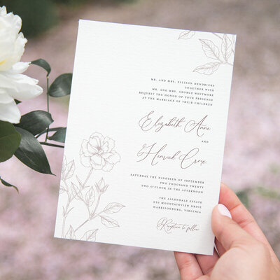 Mauve wedding invitation with fine line florals