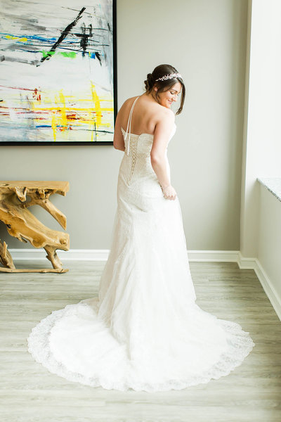 Bride posing for a photophotographed at the Onesto in downtown Canton by a akron ohio wedding photographer