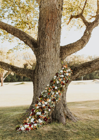 Unique outdoor wedding ceremony flower arrangement