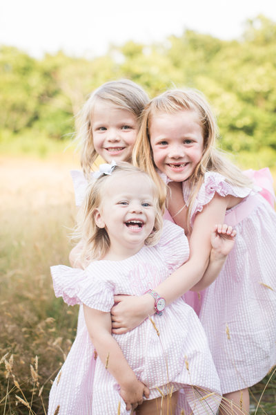 Sisters share a laugh during their family photo session