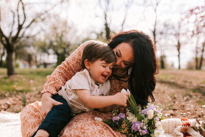 mother with son laughing and kissing on cheek