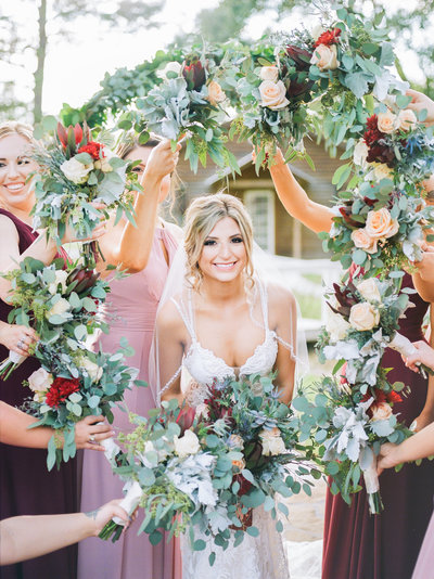 Bride and bridesmaids with bouquet wreath on film