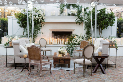 Elyse Jennings Weddings lounge in front of Il Mercato fireplace