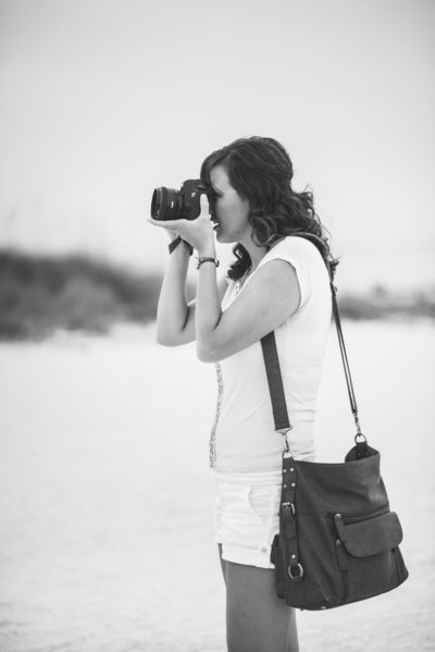 professional wedding photographer with camera on the beach