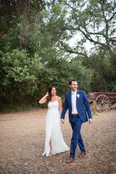 Couple walking at their wedding at Temecula Creek Inn