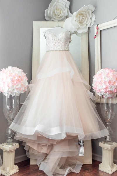 wedding dress from brilliant bridal hanging on mirror