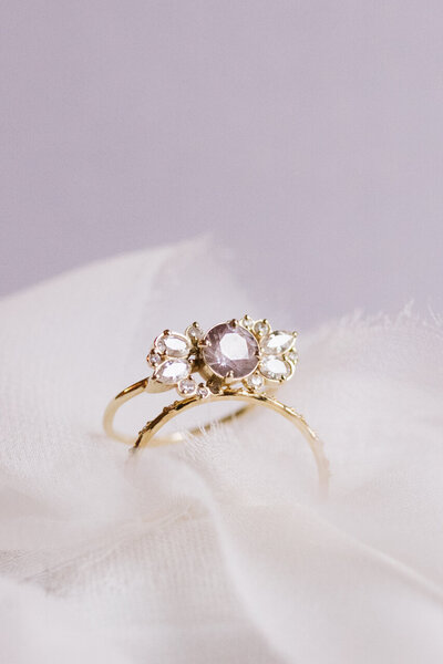 Purple stone in engagement ring gold band