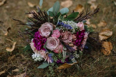 Pink purpler flowers Rose and Dahlia  gathered bridal bouquet