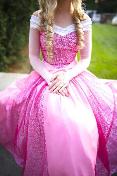 Richmond Princess Aurora sits with hands folded