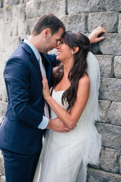 Groom embracing bride against wall while having a special moment