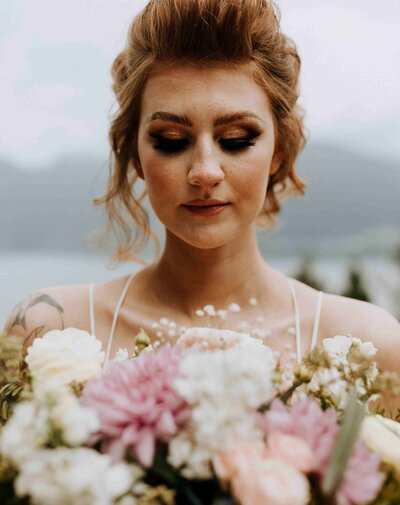 bridal makeup and flower bouquet