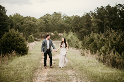 Couple walking hand in hand in Little Rock Arkansas Engagement Session