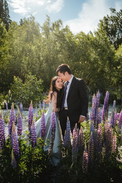 Man and Woman hugging surrounded by purple lupins
