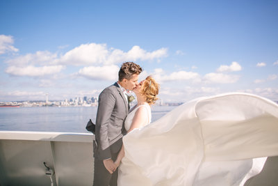 Bride and groom kissing on Bremerton Ferry to Seattle