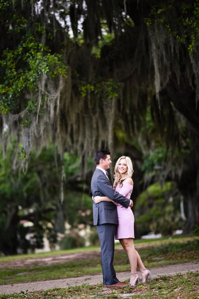 Beautiful engagement Photography: Couple in front of oaks with Spanish moss in Biloxi, Mississippi, Mississippi Photographer