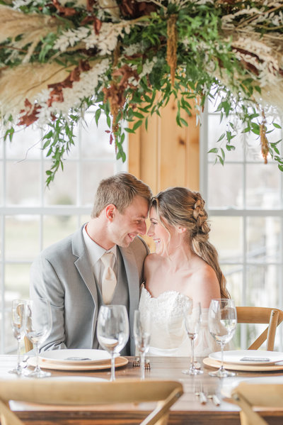 Bride and groom cuddling and smiling at their mount ida farm charlottesville wedding