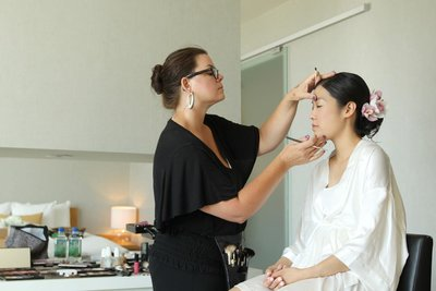 Sonia applying makeup onto Asian bride