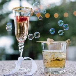 Tahoe Wedding Planners specialty drinks garnished with horseshoe stir-stick with ginger at private Incline wedding venue on Lake Tahoe, Joy of Life Events image by Elena​ Graham Photography