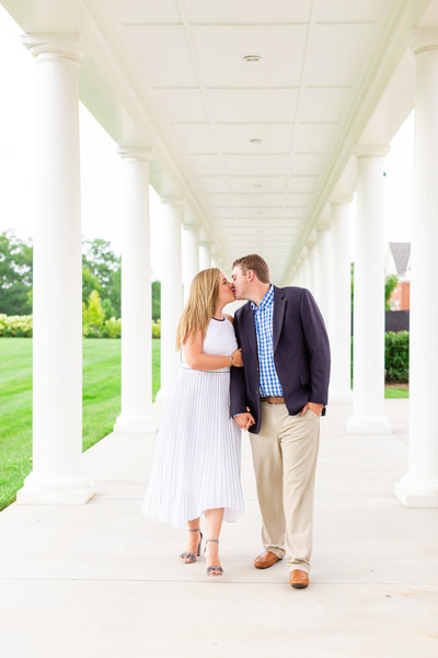 Couple shares a kiss at their engagement session in Charleston south carolina