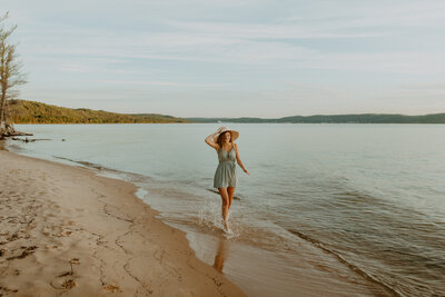 woman running on lake superior beach
