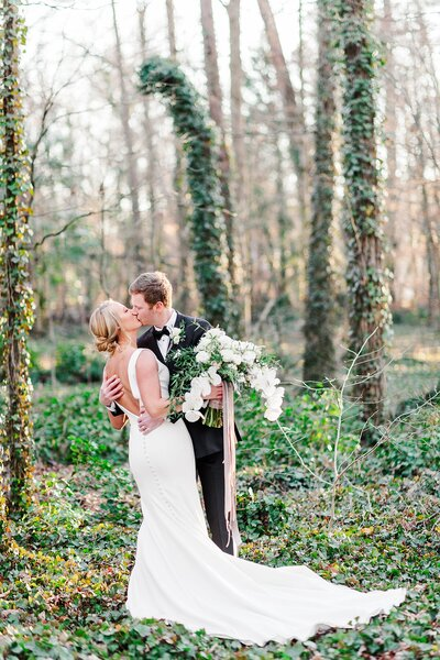 groom kissing bride by Knoxville Wedding Photographer, Amanda May Photos