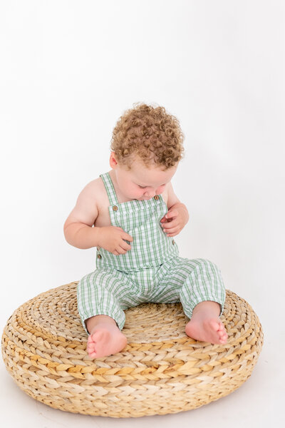 Toddler wearing a plaid romper