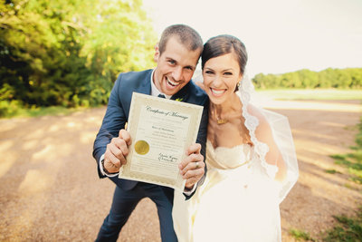 Bride and groom celebrate with their marriage license