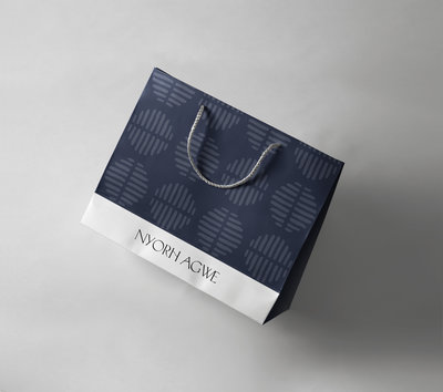 Dark blue tribal shopping bag, branding by Ile Alafia Design Co.